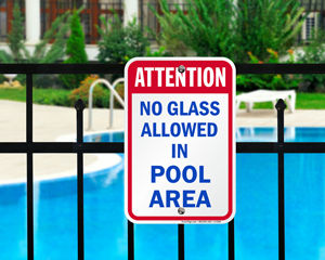 No glass allowed in pool area sign