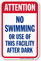 Attention No Swimming After Dark Sign