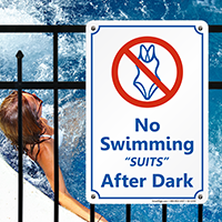 No Swimming Suits After Dark Sign