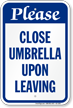 Please Close Umbrella Upon Leaving Sign